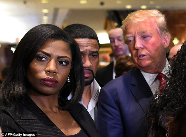 Omarosa Manigault Newman admitted Sunday that she was fired from the White House and did not resign as she claimed in previous interviews. She's seen here with her former boss, the president, in late 2015