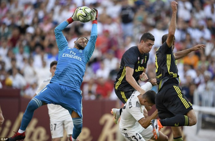 Navas catches the ball from a corner during the first half of the International Champions Cup match in Maryland