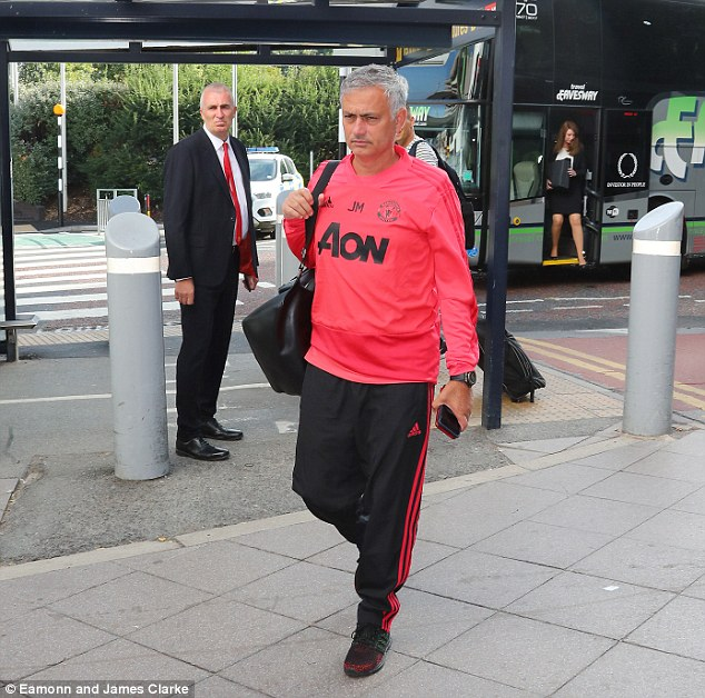 Manchester United manager Jose Mourinho follows his squad into the airport on Sunday
