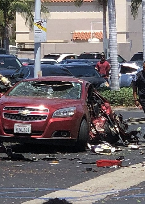 The plane also hit a car (pictured), but no one was reported injured. It remains unclear what airport the plane had departed from