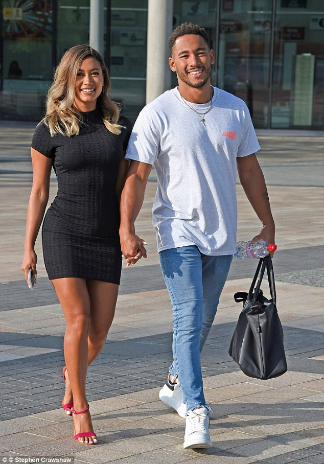 Stylish: Kaz was putting on a leggy display in a tight black ribbed dress as she exited the interview hand-in-hand with Josh
