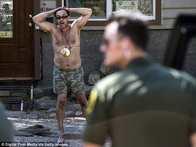 Clark stripped down to his underwear on Tuesday as authorities in Holy Jim tried to arrest him
