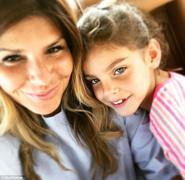 Dr Holman, pictured with Suri, has been told she may have to spend up to a year in the Arab state while the case is settled