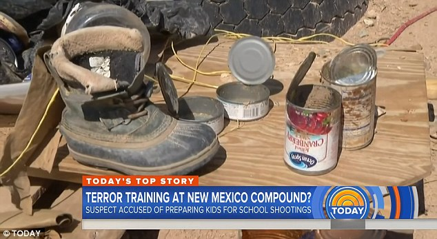 Opened cans of tuna and cranberries sit next to a dusty boot in the compound. There was no other food on the site and the children had not eaten for days when they were discovered
