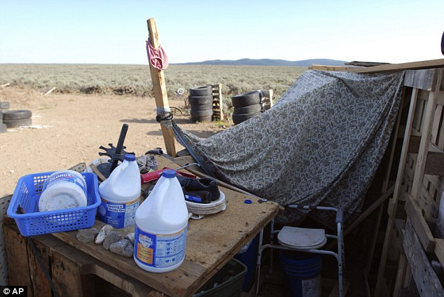 A makeshift toilet and bottles of bleach are seen in this improvised bathroom at the compound