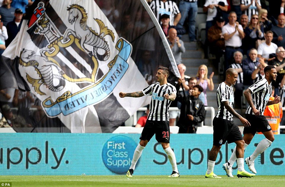 Joselu celebrates scoring Newcastle's first goal of the match in front of the home supporters on Saturday afternoon