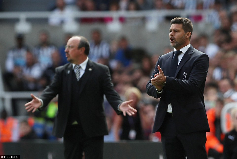Tottenham manager Mauricio Pochettino (right) and Newcastle boss Rafael Benitez on the touchline during the first half