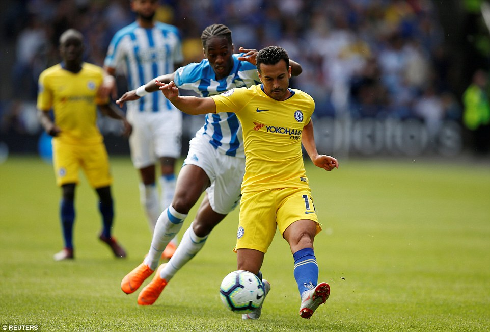 Chelsea winger Pedro looks to whip a ball forward and spark a quick counter attack asTerence Kongolo chases back
