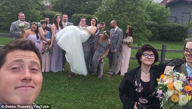 Pictured above is Russell at what appears to be at a wedding. He posted the photo at the end of one of his YouTube videos