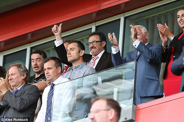 Paying tribute: Paul Chuckle looked emotional as he's seen for the first time since brother Barry's death aged 73 at a Rotherham football match on Saturday