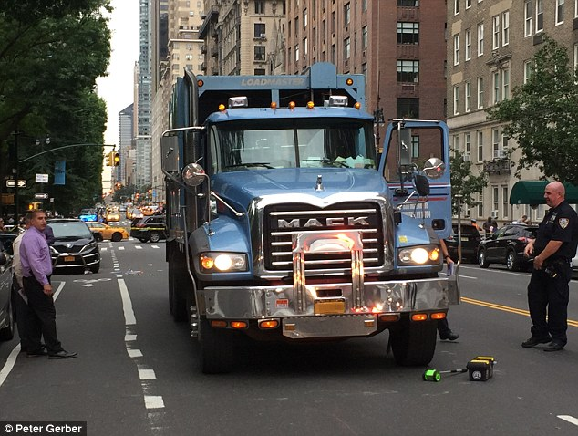 The driver of the car and the truck both remained at the scene to give NYPD officers their statements while the NYPD¿s Collision Investigation Squad investigated