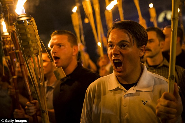 Last year's rally on August 12 saw rally-goers carry flaming torches (pictured) and clash with counter-protesters