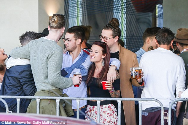 One particularly cheery group can be seen with red cups and embracing one another, donned in casual clothing rather than the fitness attire many others are flaunting