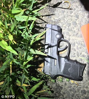 A 15-year-old was shot multiple times by police after he allegedly opened fire at a memorial for gun-violence victims in Queens on Friday night. The handgun above was found near the wounded teen