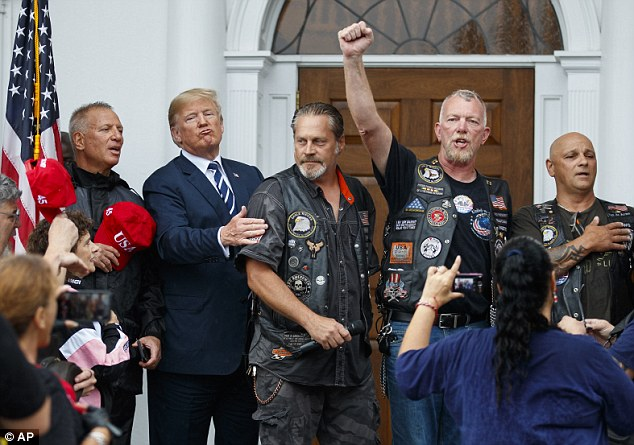 Trump appeared in a better mood when he greeted bikers on Saturday, who chanted 'Four more years!' and 'USA!' as he entered the ballroom. Rain streamed down the windows and pools formed on the empty golf greens outside