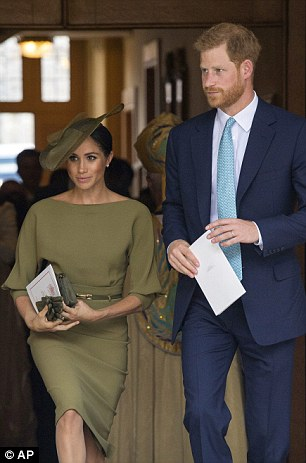 Harry and Meghan pictured together at the christening of Prince Louis