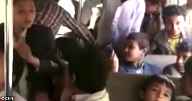 Heartbreaking:The video shows the excited children playing around on the bus, just hours before it was hit by a missile in Dahyan, Saada province, Yemen, killing 40 of them