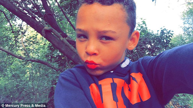 Eight-year-old Fabian Butler, from Gwent (pictured with makeup) loves wearing women's clothing and has already decided to wear a dress to prom when he turns 16. He also enjoys wearing pink hair extensions