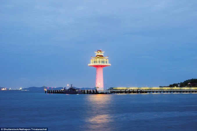 The Ban Tha Thewawong Lighthouse in Thailand is a white tower supported by a broad square upper section with a viewing platform and topped by a lantern under temple-like roofs. The total height is 128ft. Built in 2012, it is privately maintained and lit up at night. It also emits a white flash every 3.3 seconds