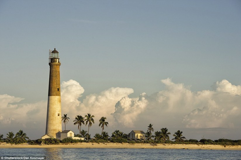 The Dry Tortugas Lighthouse at Loggerhead Key in Florida is the remotest lighthouse of the United States, established in 1858. Built of brick, in standard frustum form, it is 157ft tall. The light was electrified in 1933, and automated in 1988. Since 2015 it has been operated by a VRB-25 beacon