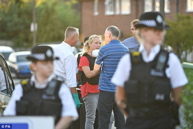 Police talk to residents in Adderley Gardens, Greenwich, south-east London