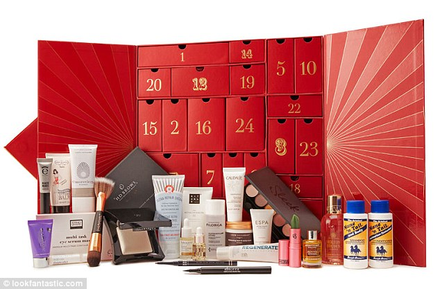 Treats worth £300 in the Lookfantastic Advent Calendar, costing £79, include a Lipstick Queen Frog Prince Lipstick, Illamasqua Beyond Powder in Deity; Omorovicza Moor Cream Cleanser; Percy & Reed Perfectly Perfecting Wonder Balm; Mane 'n Tail shampoo and conditioner. Pre-orders open on 7th September and it's available to buy on 1st October