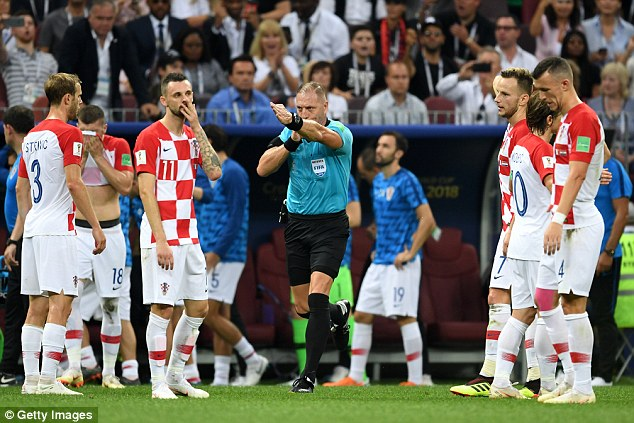 Referee Nestor Pitana awards a penalty in the World Cup final after consulting VAR