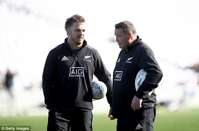 All Blacks coach Steve Hansen talks to flanker Sam Cane, who may miss the clash with injury