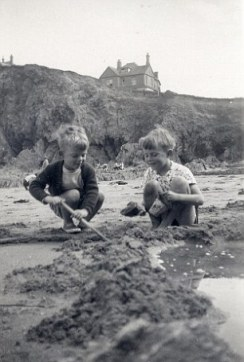 Their hero: Peter and his brother Christopher in 1955 and their father Eric, a Royal Navy officer, in 1950