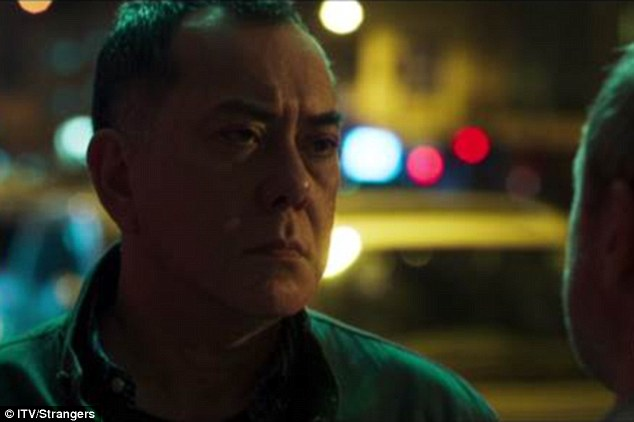 At a police station Professor Mulray came face-to-face with his wife's first husband David Chen, played by Anthony Wong (pictured), to whom she had been married for 20 years and with whom she shared a teenage daughter
