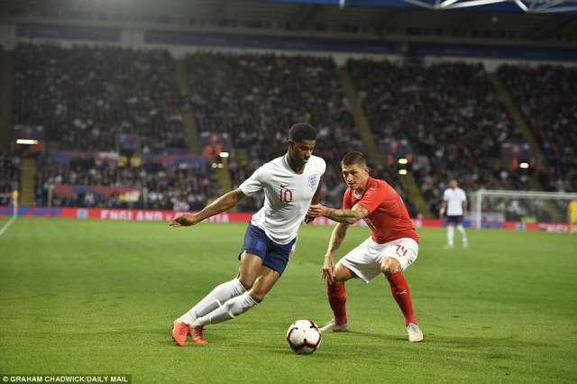 Rashford tries to escape the attention of his Swiss marker as the Three Lions go in search of their second goal