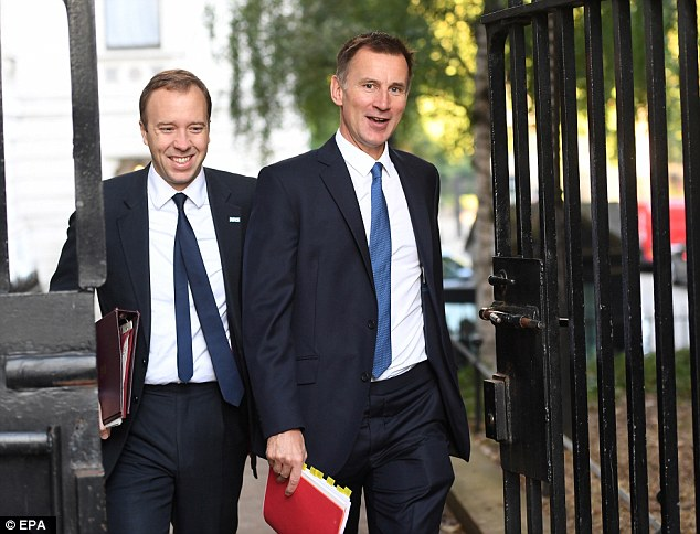 Health Secretary Matt Hancock (left) and Foreign Secretary Jeremy Hunt (right) were all smiles as the arrived for the no-deal discussions today