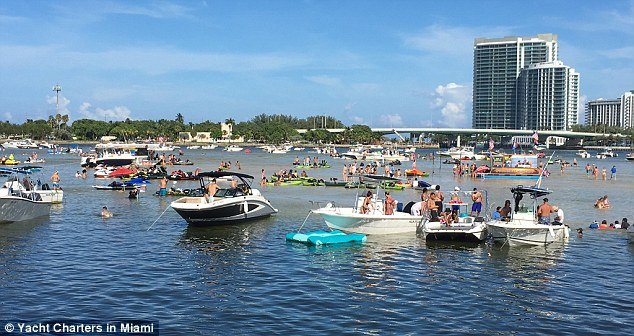 Revellers in Miami can be seen drifting towards a sandbar, with a range of vessels out on the water