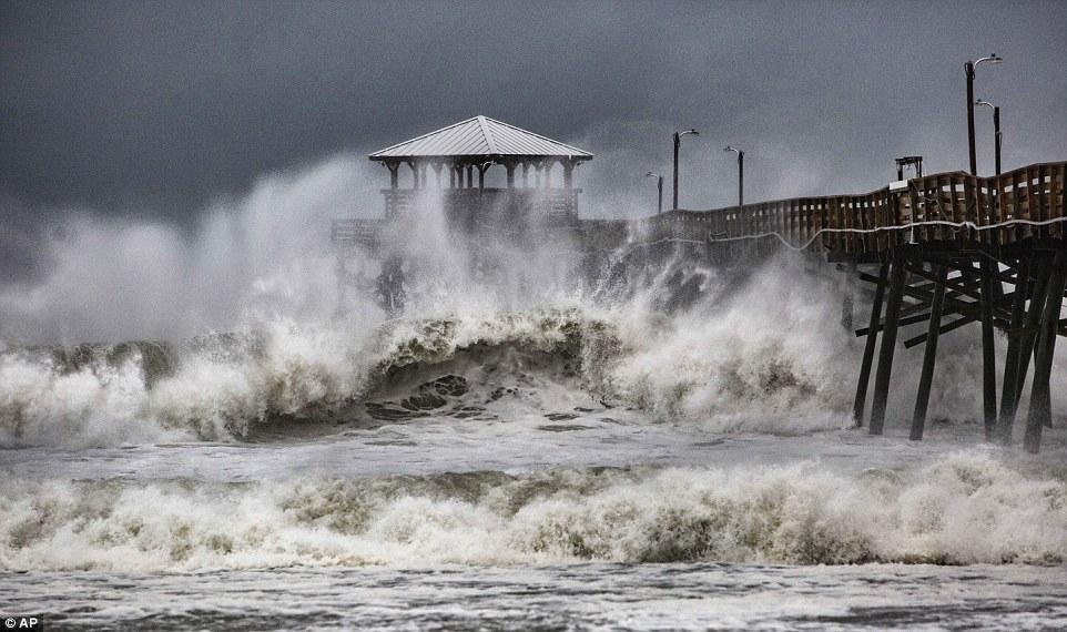 Waves slam the Oceana Pier & Pier House Restaurant in Atlantic Beach, North Carolina as Hurricane Florence approaches the area on Thursday