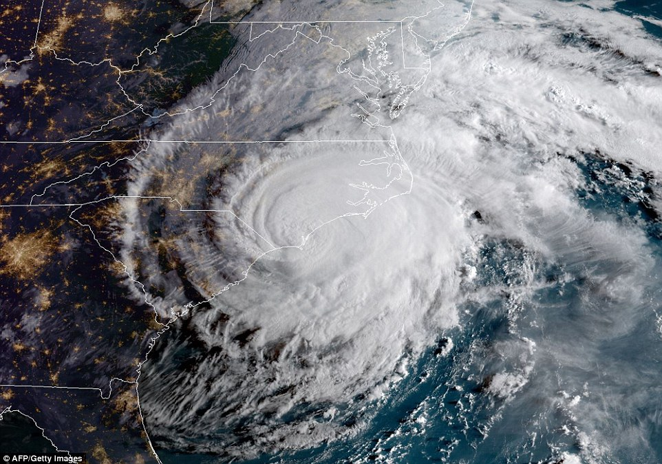 This satellite map shows Florence making landfall on the East Coast on Friday with 90mph winds causing havoc for people who decided to stay put