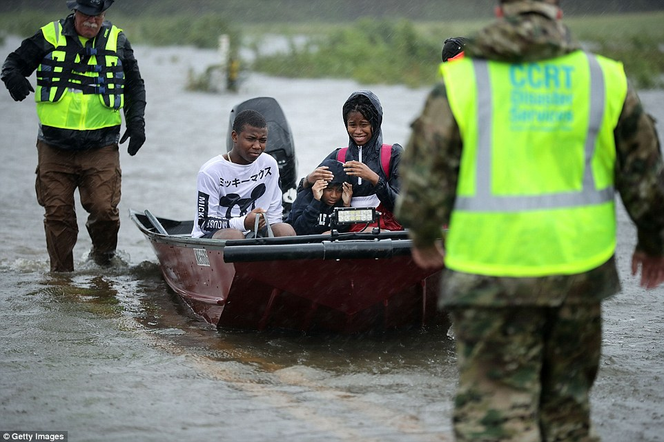 The volunteers moved the three James City children to safety on Friday along a flooded highway in a motorboat. Hundreds of other people have had to call for emergency rescues in the area around New Bern, North Carolina