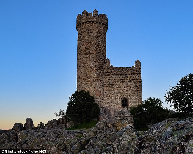 Pictured is the watchtower of Torrelodones, in Madrid photographed at sunset. It's unclear how Elon Musk plans to design the headquarters to resemble the iconic medieval architecture
