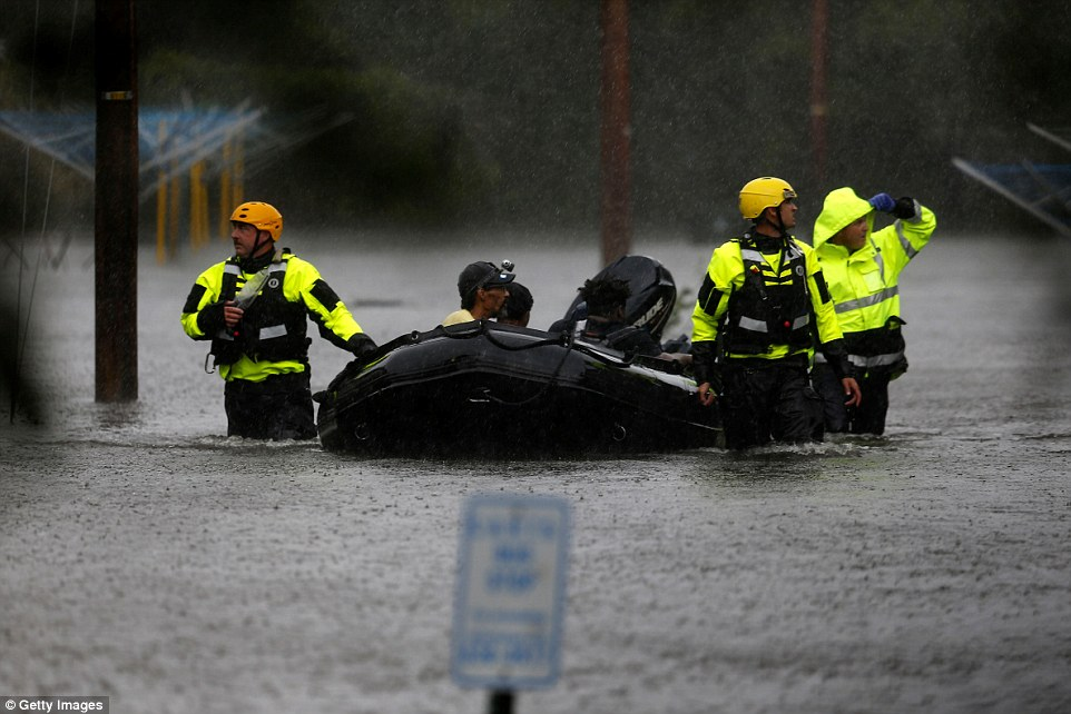 Rescuers bring residents to safety after they remained in the mandatory evacuation zone during Hurricane Florence