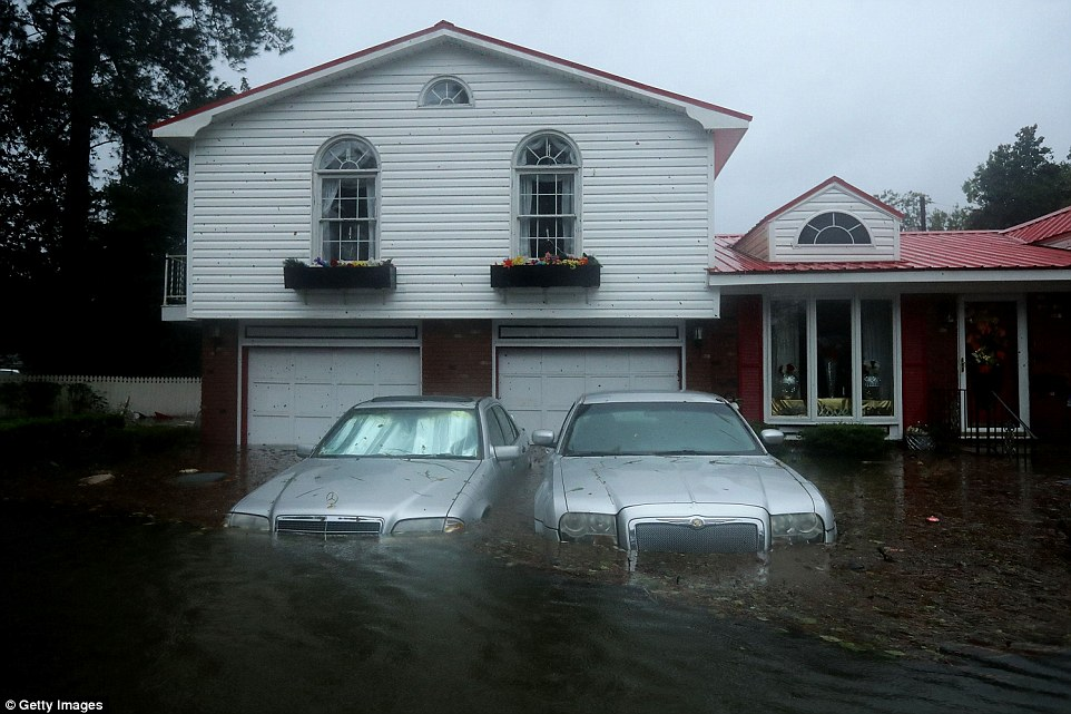 Homes are flooded after a storm surge from Hurricane Florence flooded the Neuse River on Friday in New Bern