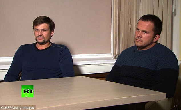 A screenshot taken on September 13, 2018, of footage broadcast by Russia's state broadcaster Russia Today (RT) shows two men, allegedly Alexander Petrov and Ruslan Boshirov, attending a television interview