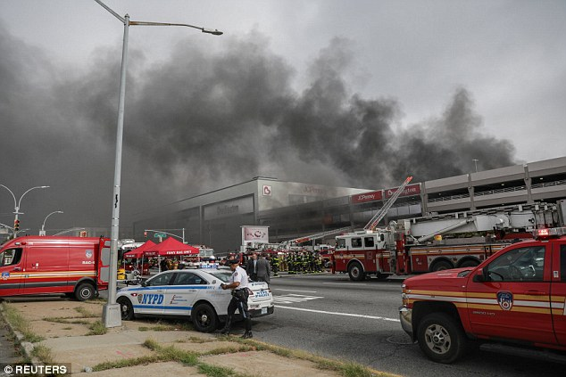 A large blaze began Monday morning at a parking garage of the Kings Plaza Shopping Center in Brooklyn Massive fire tears through Brooklyn shopping center parking garage