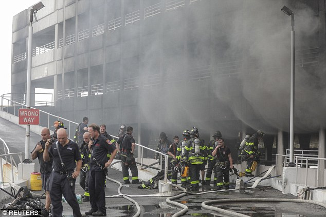 More than 200 firefighters are trying to put out the seven alarm fire