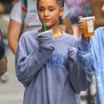 Ariana Grande step out in the rain in NYC