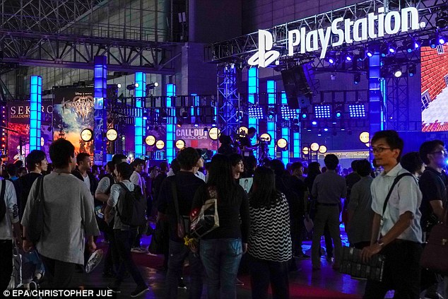 Visitors gather near the Sony PlayStation exhibition booth during the Tokyo Game Show 2018 at Makuhari Messe in Chiba, east of Tokyo, Japan, 20 September 2018