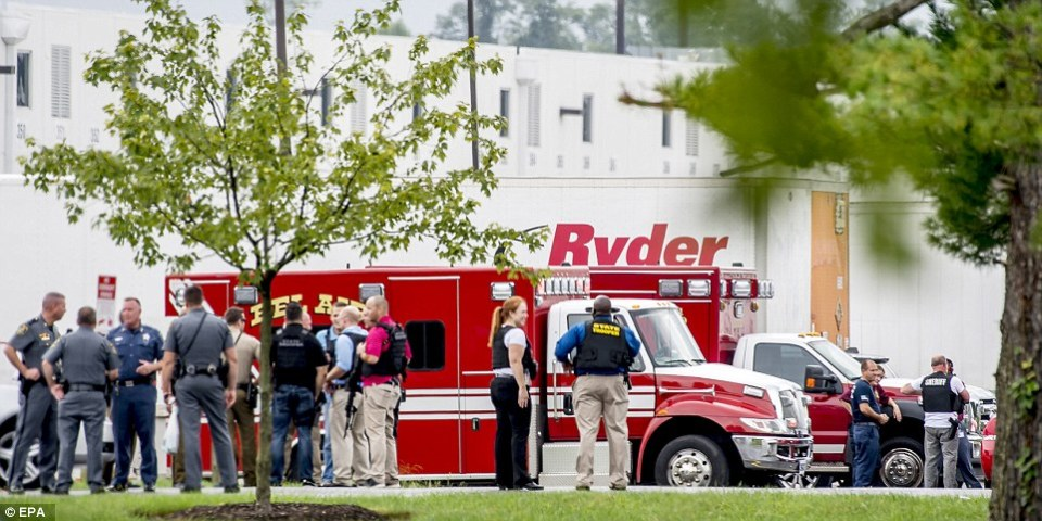 Ambulances and fire trucks are pictured at theEnterprise Business Park following the deadly shooting on Thursday morning
