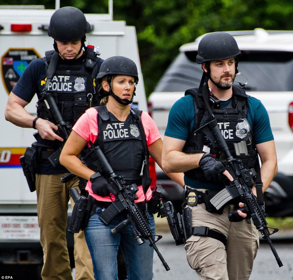 Armed officers from the Bureau of Alcohol, Tobacco and Firearms were on the scene along with local law enforcement and FBI agents