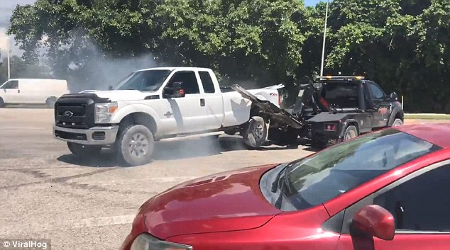 This is the moment a man who had his truck repossessed attempts to get it back