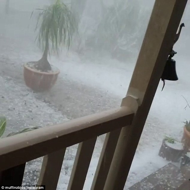 Destructive winds and large hailstones (pictured) are likely to continue with a potential tornado