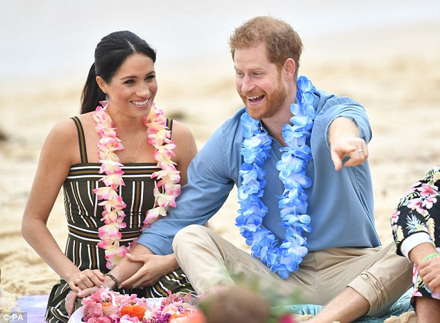 Meghan kept accessories to a minimum, wearing a simple $418 teardrop pendant from Los Angeles jewellery designer Adina Reyter (pictured on the beach with Prince Harry)