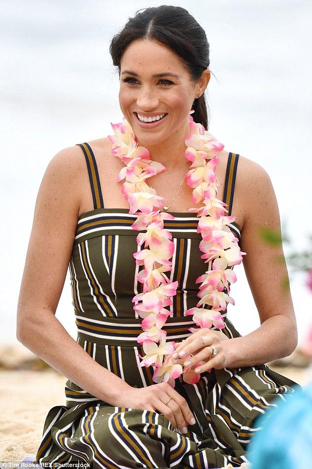 Meghan Markle stunned in yet another Australian designer on Thursday, when she plumped for a Martin Grant khaki dress and espadrilles to visit Bondi Beach